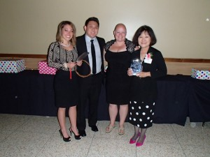 The Seattle JACL 92nd Annual Banquet honored Marsha Aizumi (far right), pictured here with (from left) Seattle JACL President Toshiko Hasegawa and Aiden and Mary Aizumi.