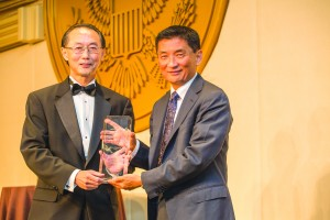 David Lin (left) presents IW Group's Bill Imada with his award. Photo by Joe Shymanski