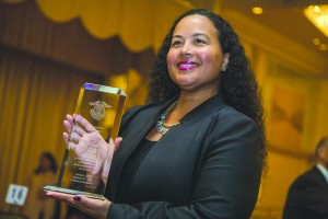 "CBS' Tiffany Smith-Anoa'i accepts an award on behalf of ""Hawaii Five-0"" writers Peter Lenkov and Ken Solarz. Photo by Joe Shymanski"