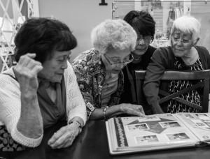 Aya Fujii and friends look at Aya's family scrapbook at Four Rivers Cultural Center, Ontario, Oregon. Photo by Rich Iwasaki