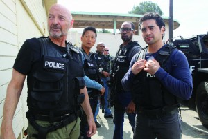"""The elite Gang Task Force in a scene from the show """"Gang Related""""."""