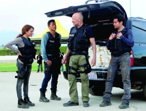 """A scene from """"Gang Related"""" with (from left) Inbar Lavi, Sung Kang and Terry Quinn."""