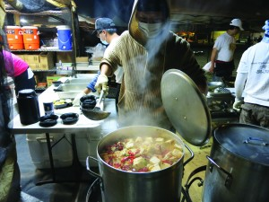 Large pots of stinky tofu fill the night market air with stench and spice. Photo by Tiffany Ujiiye