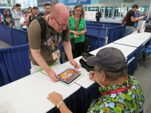 Willie Ito at his Comic Con booth where he signed autographs and met fans after his spotlight discussion. Photo by Tiffany Ujiiye