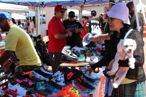 A woman inquires about a pair of Jordan 11's at Little Tokyo's DXC. Photo by Tiffany Ujiiye