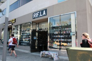 RIF storefront with its iconic bench is a popular photo op for customers and celebrities. Photo by Tiffany Ujiiye