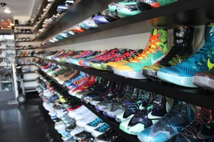 Inside RIf's store sits rows of shrink-wrapped sneakers selling anywhere from $100- $8,000. Photo by Tiffany Ujiiye