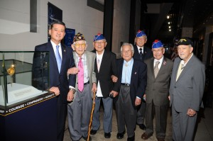 Veterans shown left to right: George Fujimoto (442), Nelson Akagi (442), Susumu Ito (442), Lawson Sakai (442), Tommie Okabayashi (442), Robert Pieser (36th Division).