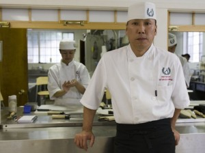 Chef Andy Matsuda stands inside the Sushi Chef Institute kitchen.