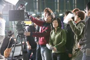 "Director Christine Yoo (center) filmed ""Wedding Palace"" in South Korea and Los Angeles."