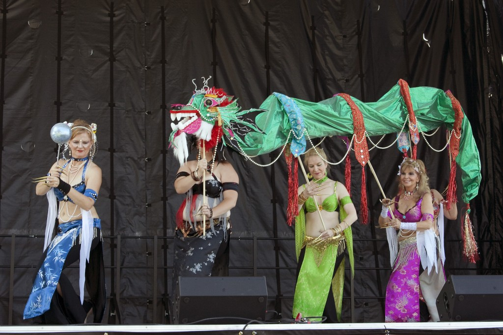 This group performed at a Denver festival and claimed it was paying homage to Chinese dragon dancing at the same time it was performing a Middle Eastern belly dance. Photo by Gil Asakawa